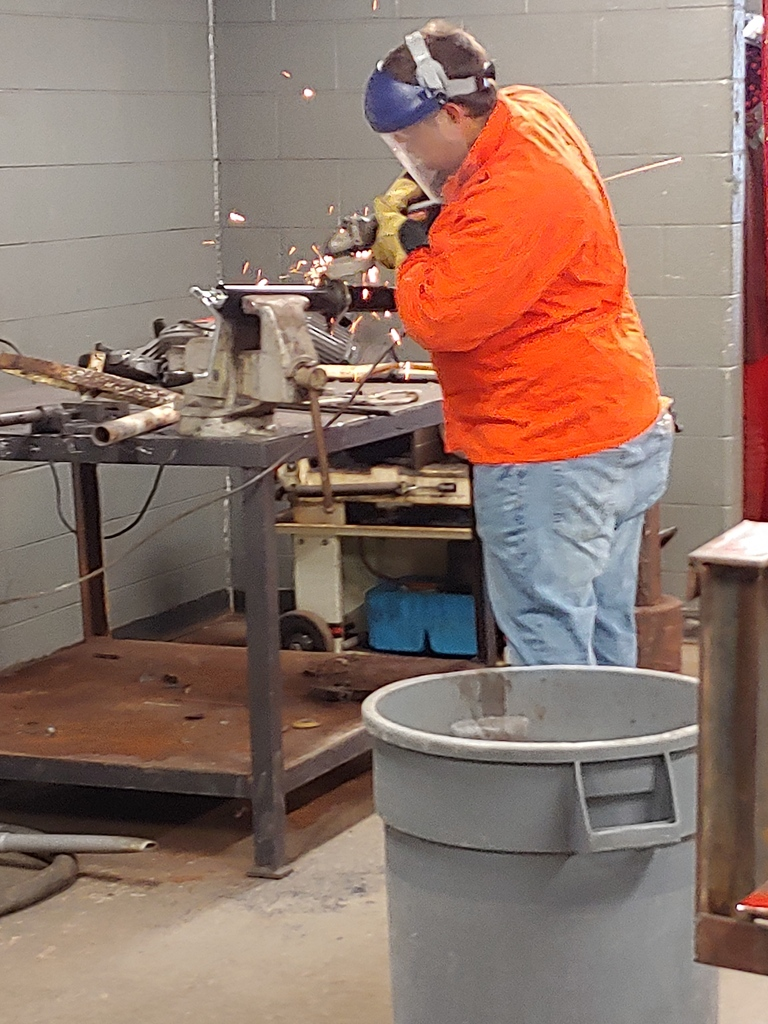 Welding student Shane Kelly, preparing a repair project on a trailer jack.